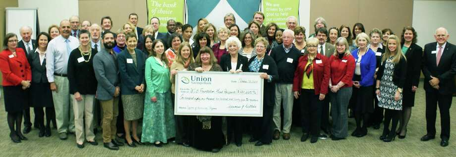 Grant recipients gather recently during the annual Union Savings Bank Foundation breakfast at the bank's North Street office in Danbury. To the right is Francis Dattalo, then USB's president and CEO. 2014 Photo: Contributed Photo / The News-Times Contributed