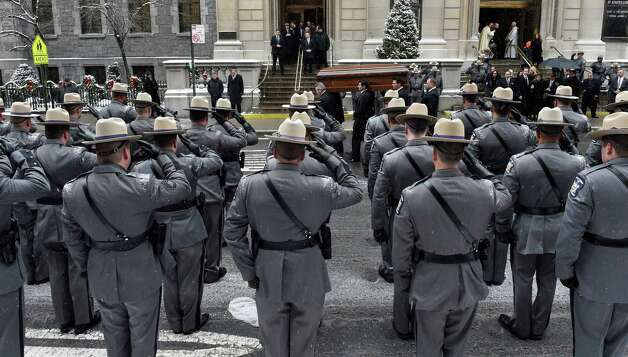 A large contingent of New York State Police salute as the casket of former Governor Mario M. Cuomo leaves St. Ignatius Loyola Church Tuesday afternoon Jan. 6, 2015 in New York City, N.Y.       (Skip Dickstein/Times Union) Photo: SKIP DICKSTEIN / 00030083A
