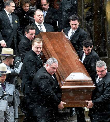 The casket of former Governor Mario M. Cuomo leaves St. Ignatius Loyola Church Tuesday afternoon Jan. 6, 2015 in New York City, N.Y. Honorary pallbearer Chris Cuomo, upper left, and five funeral home employees carry the casket. longtime political aide Joseph Percoco is behind the casket.  (Skip Dickstein/Times Union) Photo: SKIP DICKSTEIN / 00030083A