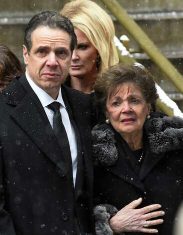 Gov. Andrew Cuomo, left, assists his mother, Matilda, from the church as he and girlfriend, Sandra Lee, center, walk behind the casket of former Governor Mario M. Cuomo following funeral services at St. Ignatius Loyola Church Tuesday afternoon, Jan. 6, 2015, in New York City, N.Y.  (Skip Dickstein/Times Union) Photo: SKIP DICKSTEIN / 00030083A