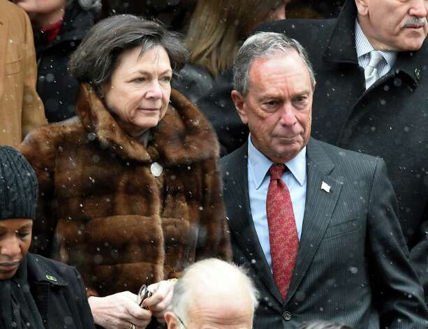 Former Nre York City Mayor Michael Bloomberg and Diana Taylor leave the church after the funeral service of former Gov. Mario M. Cuomo at St. Ignatius Loyola Church Tuesday afternoon Jan. 6, 2015 in New York City, N.Y.       (Skip Dickstein/Times Union) Photo: SKIP DICKSTEIN / 00030083A