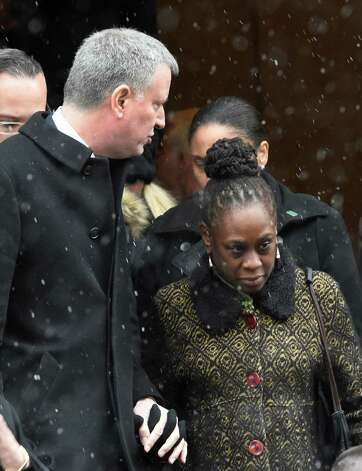NYC Mayor Bill De Blasio and his wife, Chirlane McCray, leave the church after the funeral service of former Gov. Mario M. Cuomo at St. Ignatius Loyola Church Tuesday afternoon Jan. 6, 2015 in New York City, N.Y.       (Skip Dickstein/Times Union) Photo: SKIP DICKSTEIN / 00030083A