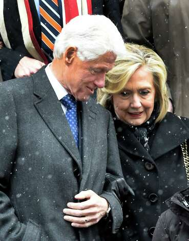 Former President Bill Clinton and his wife, former Secretary of State Hillary Clinton, leave the church after the funeral service of former Gov. Mario M. Cuomo at St. Ignatius Loyola Church Tuesday afternoon Jan. 6, 2015 in New York City, N.Y.       (Skip Dickstein/Times Union) Photo: SKIP DICKSTEIN / 00030083A