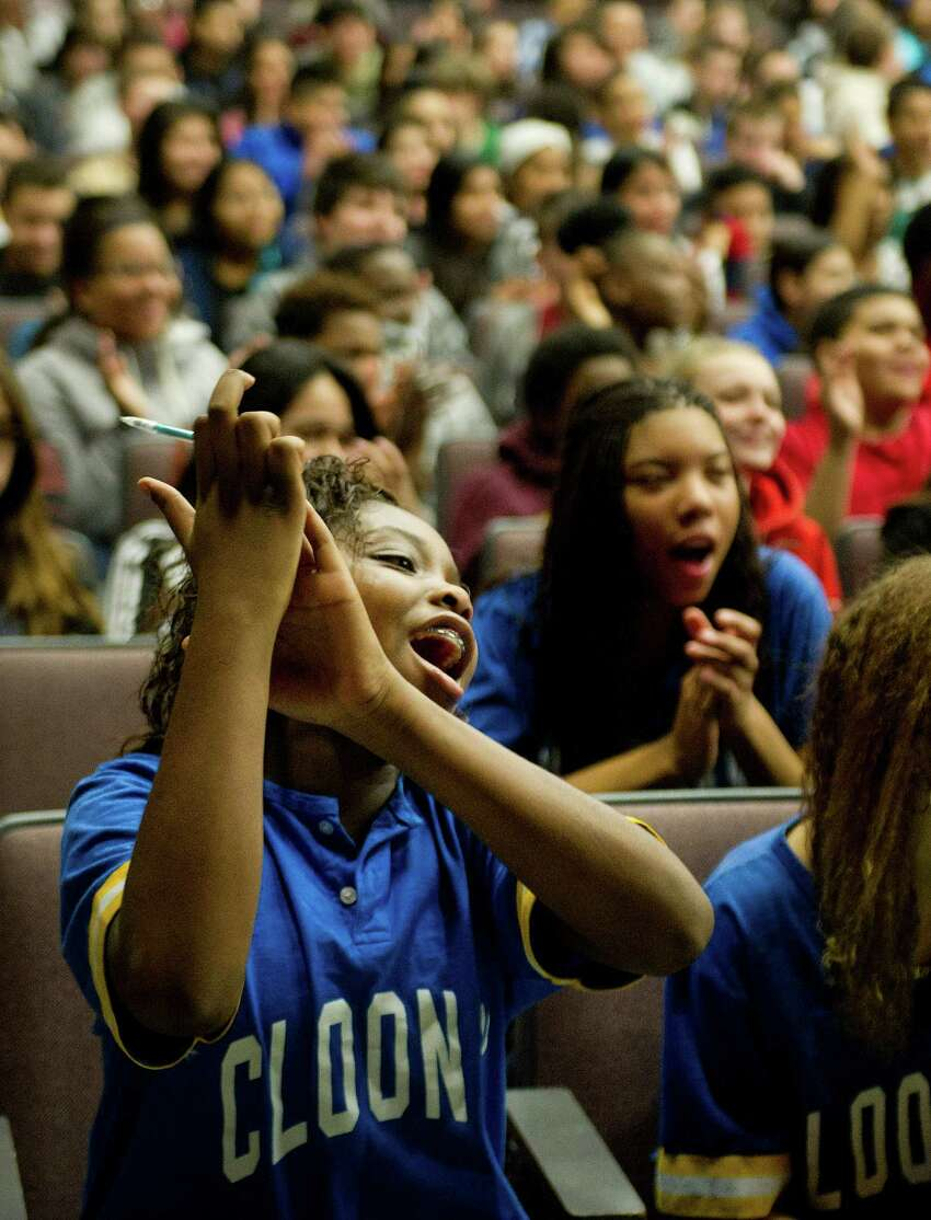 Armani McCollum, member of the Cloonan Middle School drill team, cheers for cast members from STOMP who performed at the school on Tuesday, January 6, 2015. The cast members performed for students, participated in a question and answer session, and promoted their upcoming show at the Palace Theatre.