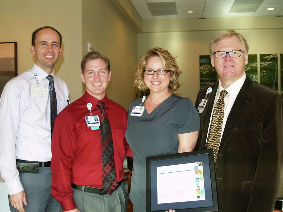 Ryan Tingey, director of operations, at Chi St. Luke's - The Vintage Hospital, left; Austen Holton, director of diagnostic imaging: Sheri Mauck, award recipient and Norman Stephens, president celebrate Mauck receiving the Mission award by the hospital. Photo: CHI St. Lukeé­s Health