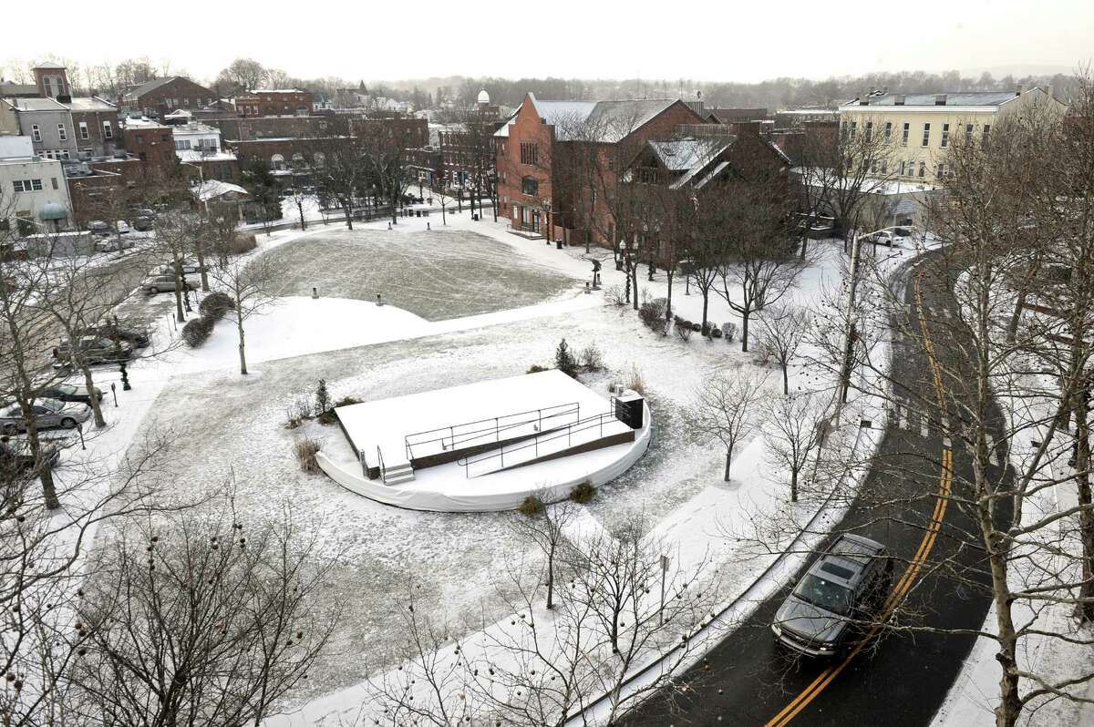 The green in downtown Danbury has a dusting of snow on it on Tuesday, January 6, 2015, in Danbury, Conn.