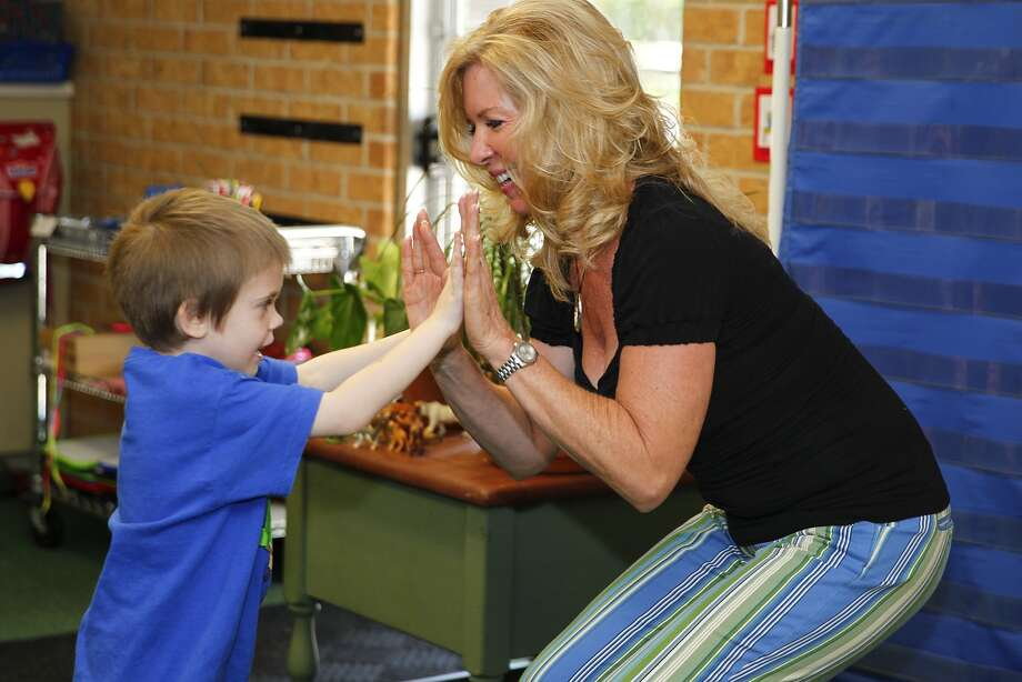 Debbie Elder, owner of the Shady Oak Primary School, dances with student Chase Higgins, 7, during music class.Debbie Elder, owner of the Shady Oak Primary School, dances with student Chase Higgins, 7, during music class. Photo: Diana L. Porter, Freelance / © Diana L. Porter
