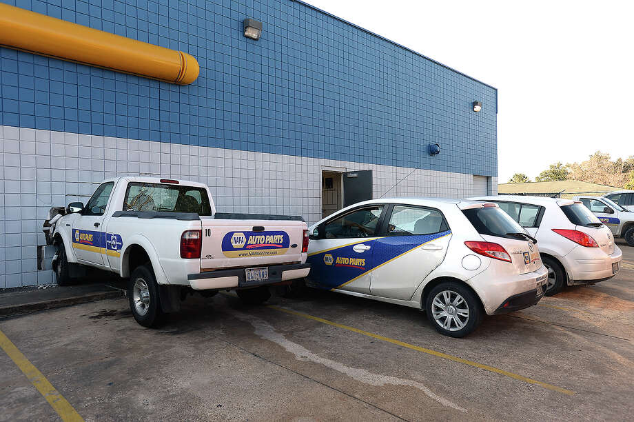 An employee at the Napa Auto Parts store on College Street was treated for minor injuries after being struck by falling debris when a Napa pickup truck struck the side of the building Tuesday afternoon.  Photo taken Tuesday, January 6, 2015 Kim Brent/The Enterprise Photo: KIM BRENT / Beaumont Enterprise