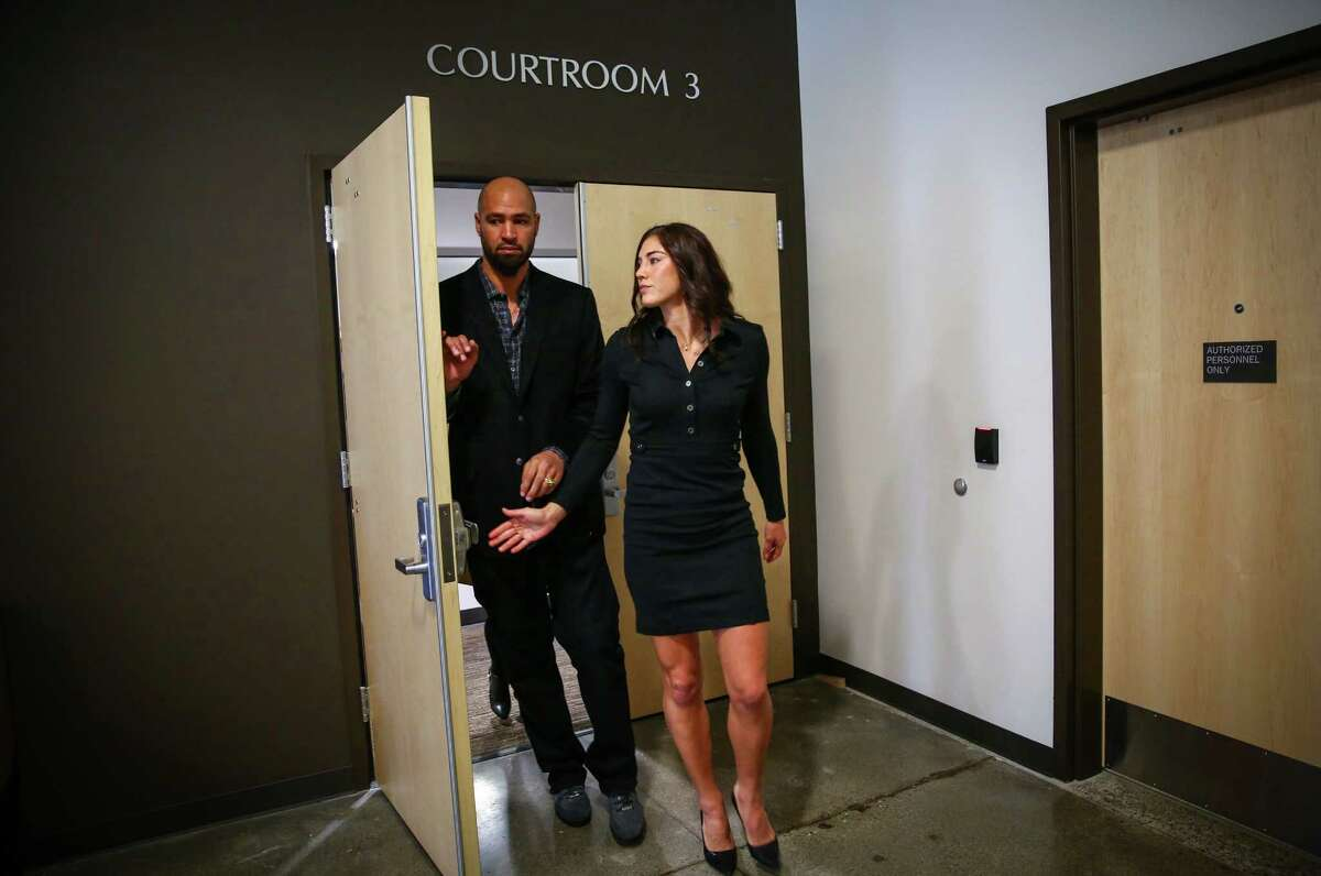 Hope Solo and her husband Jerramy Stevens walk out of the courtroom of Judge Michael Lambo after a court hearing on Jan. 6, 2015 at Kirkland Municipal Court. Solo was accused of assaulting family members at her home in Kirkland but a judge dismissed the charges on Jan. 13.