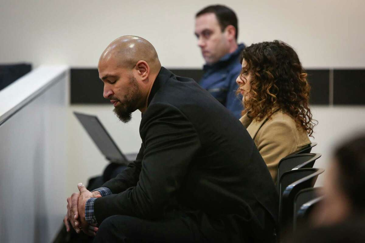 Jerramy Stevens reacts during a hearing for his wife Hope Solo in the courtroom of Judge Michael Lambo on Jan. 6, 2015 at Kirkland Municipal Court. Solo was accused of assaulting family members at her home in Kirkland.