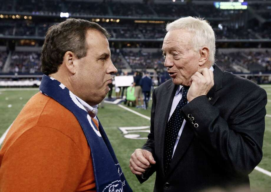 New Jersey Gov. Chris Christie talks with Dallas Cowboys owner Jerry Jones, on the field as the teams warm up before the game against the Indianapolis Colts on Dec. 21, 2014, at AT&T Stadium in Arlington. Photo: Brandon Wade /Associated Press / FR168019 AP
