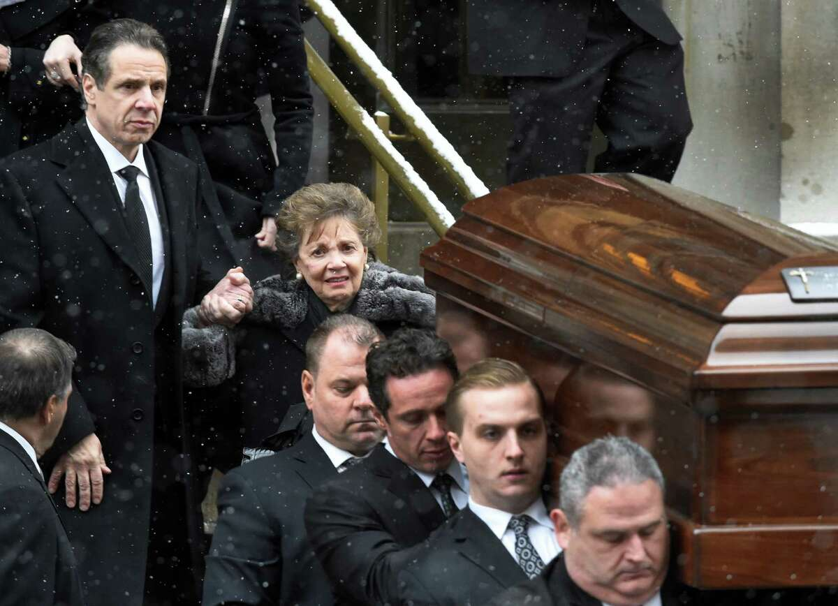 Governor Andrew Cuomo, left assists his mother Matilda from the church as the casket of former Governor Mario M. Cuomo leaves St. Ignatius Loyola Church Tuesday afternoon Jan. 6, 2015 in New York City, N.Y. Carrying the casket is honorary pallbearer Chris Cuomo, and five funeral home employees. Directly behind Chris Cuomo is longtime aide Joseph Percoco. (Skip Dickstein/Times Union)