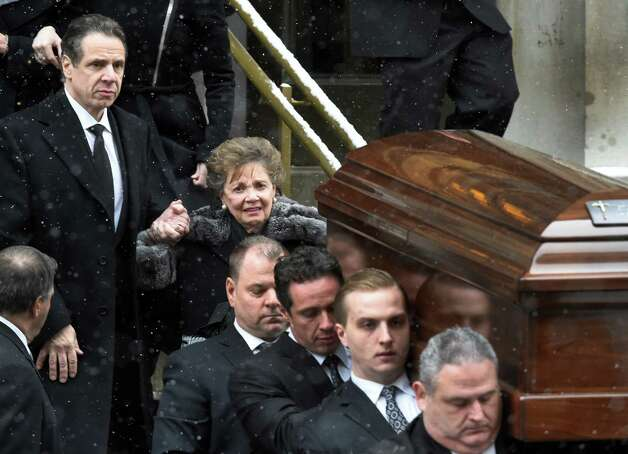 Governor Andrew Cuomo, left assists his mother Matilda from the church as the casket of former Governor Mario M. Cuomo leaves St. Ignatius Loyola Church Tuesday afternoon Jan. 6, 2015 in New York City, N.Y. Carrying the casket is honorary pallbearer Chris Cuomo, and five funeral home employees. Directly behind Chris Cuomo is longtime aide Joseph Percoco. (Skip Dickstein/Times Union) Photo: SKIP DICKSTEIN / 00030083A