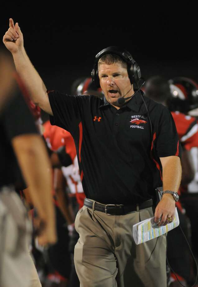 After 15 years patrolling the sidelines for Westfield, Corby Meekins will now move up to coach tight ends at the University of Houston. Photo: Jerry Baker, Freelance