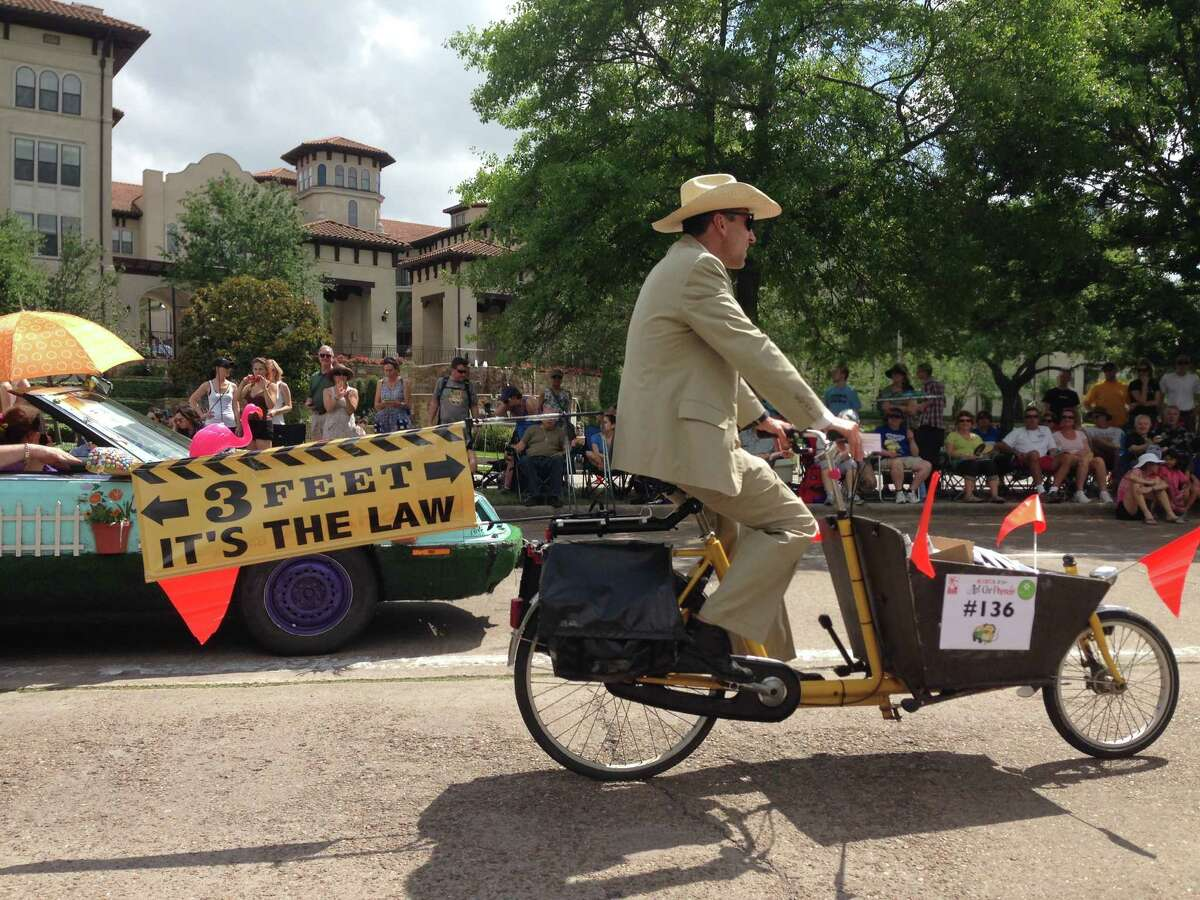 A bicyclist rides in the Houston Art Car Parade on May 10, 2014, to raise awareness of the city's safe passing law, which requires drivers to give cyclists and pedestrians three feet of space.