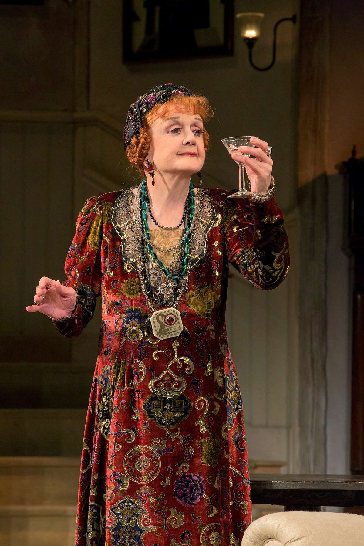 """This 2014 photo provided by the Centre Theatre Group shows, Angela Lansbury, in the North American tour of Noel Coward's """"Blithe Spirit"""" at the Center Theatre Group/Ahmanson Theatre from Dec. 9, 2014, through Jan. 18, 2015, in Los Angeles. (AP Photo/Centre Theatre Group, Joan Marcus)"""