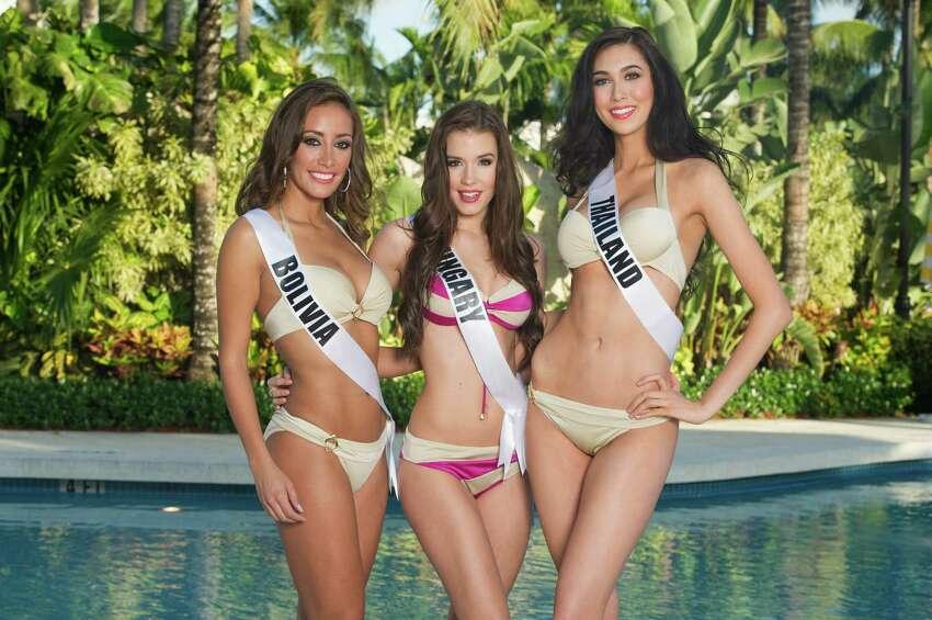 Claudia Tavel, Miss Bolivia 2014; Henrietta Kelemen, Miss Hungary 2014; and Pimbongkod Chankaew, Miss Thailand 2014.