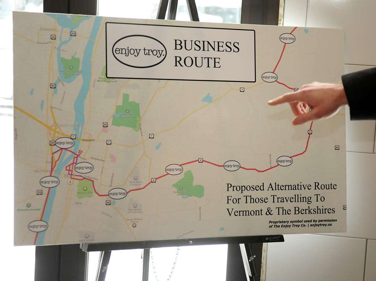 Troy businessman Duncan Crary points to a map of the proposed