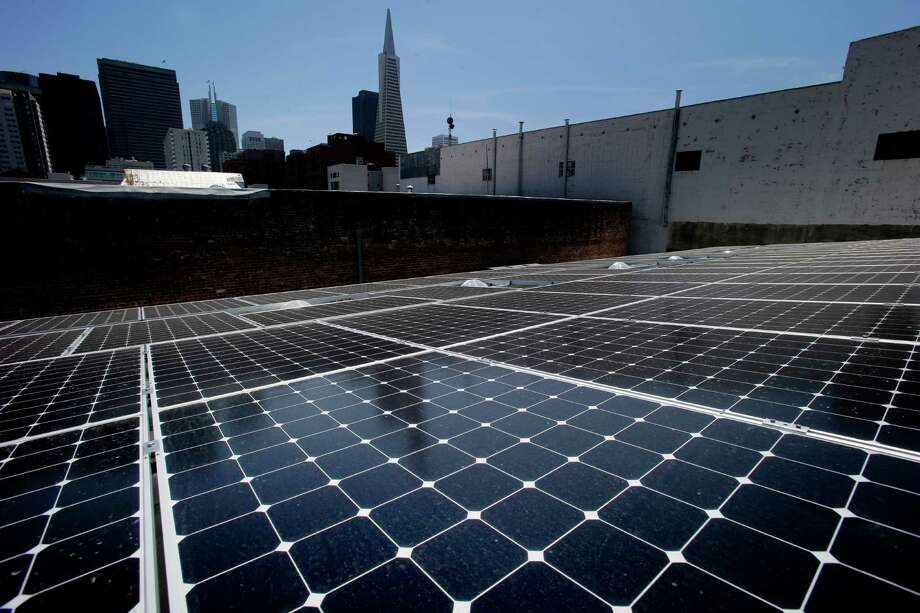 "State-of-the-art solar panels pick up the afternoon sun on the rooftop of DPR Construction in San Francisco, which has moved into the first ""zero net energy"" office building in the city. The building was renovated to produce as much energy as it uses over the course of a year. Photo: Brant Ward / The Chronicle / ONLINE_YES"