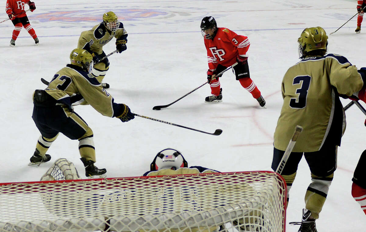 Fairfield Prep's Skyler Celotto prepares to score a goal against Notre Dame of Fairfield, during boys hockey action at the Webster Bank Arena in Bridgeport, Conn. on Tuesday Jan. 6, 2015.