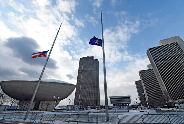 Flags are at half staff over the Empire State Plaza Friday morning Jan. 2, 2015 in Albany, N.Y. after the passing of former Governor Mario Cuomo yesterday.     (Skip Dickstein/Times Union) Photo: SKIP DICKSTEIN, ALBANY TIMES UNION