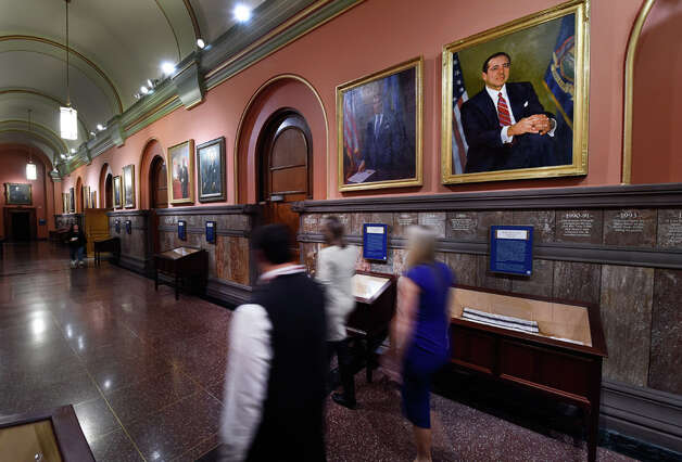 Workers pass the official painting of Governor Mario Cuomo hanging in the Hall of Governors in the State Capitol Friday morning Jan. 2, 2015 in Albany, N.Y. Former Governor Mario Cuomo passed away due to natural causes at the age of 82 yesterday.     (Skip Dickstein/Times Union) Photo: SKIP DICKSTEIN, ALBANY TIMES UNION