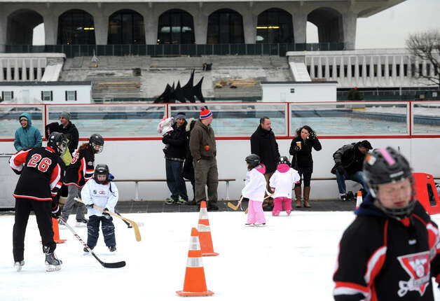 Parents watch as children and instructors take to the ice during a event designed to provide kids ages 4 to 9 a free experience to try youth hockey at the Empire State Plaza ice rink on Saturday Jan. 3, 2015 in Albany, N.Y. (Michael P. Farrell/Times Union) Photo: Michael P. Farrell, Albany Times Union / 00029990A