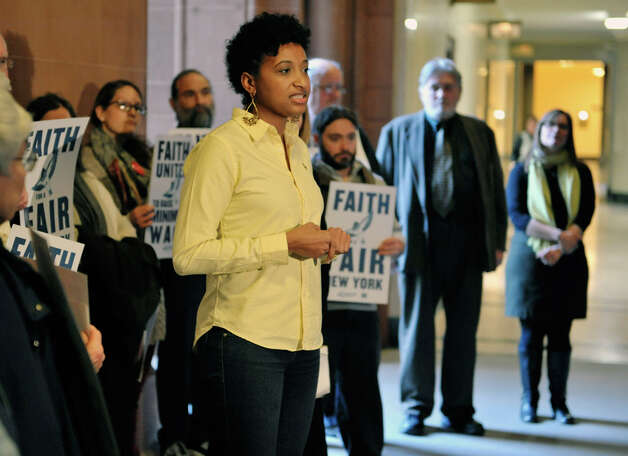 Jasmine Gripper with the Alliance for Quality Education addresses those gathered during a rally at the Capitol on Monday, Jan. 5, 2015, in Albany, N.Y.  The rally was held to call on legislators to move forward with a policy agenda that prioritizes good jobs with living wages.  (Paul Buckowski / Times Union) Photo: Paul Buckowski, Albany Times Union / 00030075A