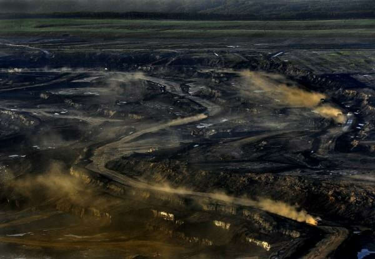 The vast Alberta oil sands project, often compared to Mordor from Lord of the Rings: The expanded TransMountain Pipeline would carry up to 890,000 barrels a day of heavy tar sands crude oil south to an oil export terminal in Burnaby, B.C., just east of Vancouver. (Getty Images)