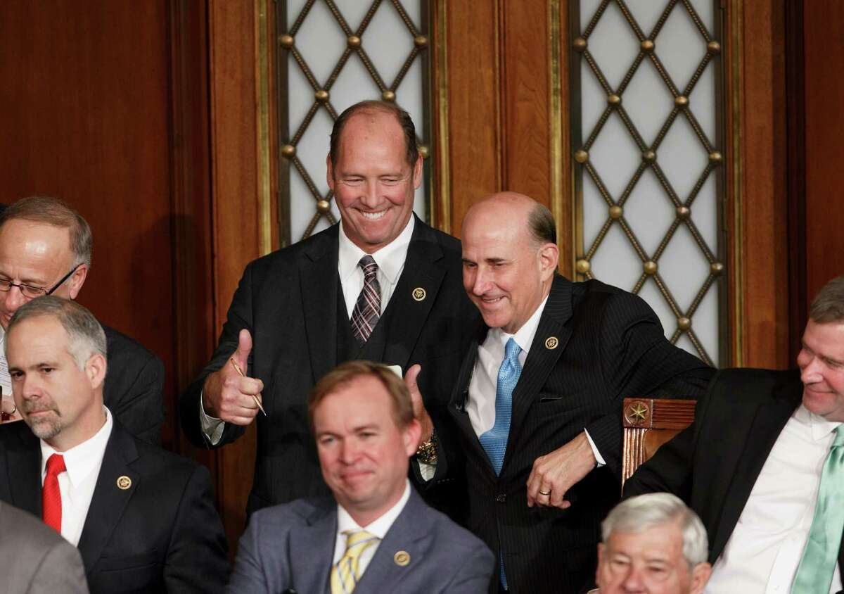 Rep. Ted Yoho, R-Fla., signals a thumbs up as he and Rep. Louie Gohmert, R-Texas, center right, voted for themselves during their challenges to House Speaker John Boehner on Tuesday.