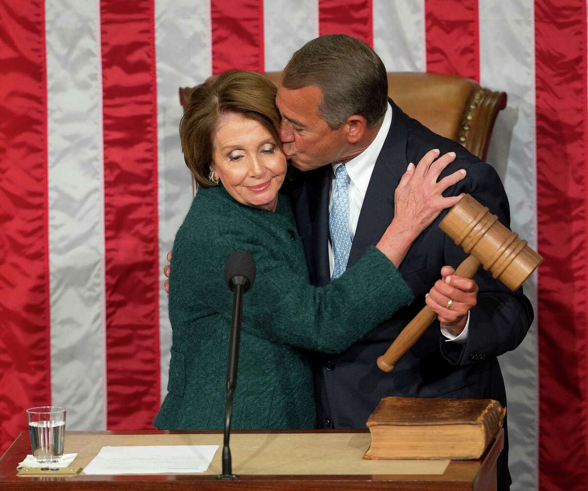 House Speaker John Boehner kisses House Minority Leader Nancy Pelosi after he was re-elected to a third term during the opening of the 114th Congress.