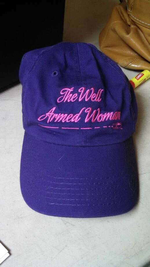 "A purple cap with ""A Well Armed Woman"" embroidered on it on display at the Iroquois Rod and Gun Club. (Leigh Hornbeck/Times Union)"