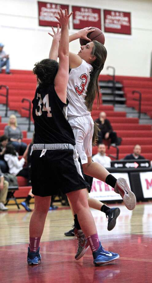 Mask's Taylor Iorfino (34) drives to the basket through Immaculate's Kathryn Kerins (34) during the girls varsity high school basketball game between Immaculate-Danbury and Masuk on Tuesday, January 6, 2015, played at Masuk High School, Monroe, Conn. Photo: H John Voorhees III / The News-Times