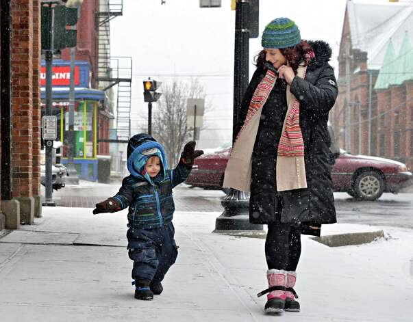 Erin Dodge of Albany and her 3-year-old son Gino take a chilly morning walk along Lark St. on their way to breakfast  Tuesday morning, Jan. 6, 2015, in Albany, N.Y. (John Carl D'Annibale / Times Union) Photo: John Carl D'Annibale