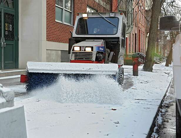 A sidewalk sweeper clears the snow from a sidewalk along 2nd Ave. near Russell Sage College on Tuesday, Jan. 6, 2015 in Troy, N.Y.  (Lori Van Buren / Times Union) Photo: Lori Van Buren