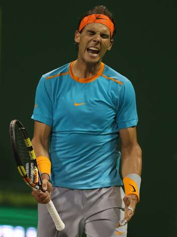 Spanish tennis player Rafael Nadal reacts after losing his tennis match against Michael Berrer of Germany in Qatar's ExxonMobil Open on January 6, 2015, in Doha. Berrer won the match 1-6, 6-3, 6-4. AFP PHOTO / AL-WATAN DOHA / KARIM JAAFAR ==QATAR OUT==KARIM JAAFAR/AFP/Getty Images Photo: KARIM JAAFAR / AFP