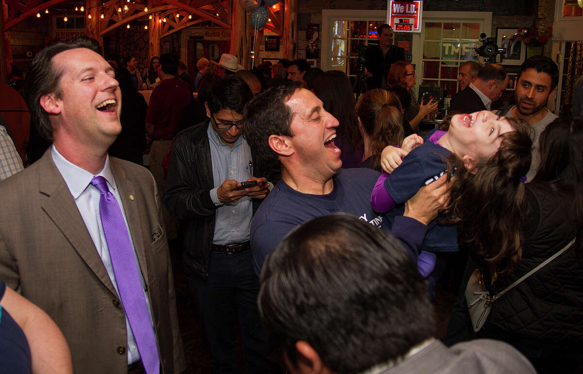 State Rep. Trey Martinez Fischer with his daugher Camilla, 4, and Dennis Speight (left) waiting for District 26 special election results, Tuesday, Jan. 6, 2015 at Henry's Puffy Tacos.