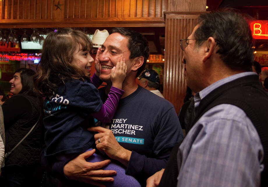 State Rep. Trey Martinez Fischer with his daugher Camilla, 4, and Lorenzo Gonzalez (right) waiting on District 26 special election results, Tuesday, Jan. 6, 2015 at Henry's Puffy Tacos. Photo: Alma E. Hernandez, Alma E. Hernandez / For The San