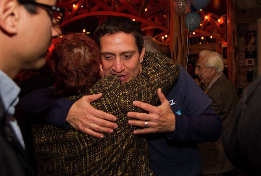 State Rep. Trey Martinez Fischer hugs Qeta LaGrange, Tuesday, Jan. 6, 2015 at Henry's Puffy Tacos as they wait on District 26 special election results.