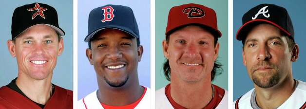 FILE - From left are Craig Biggio in 2007, Pedro Martinez in 2008, Randy Johnson in 2003 and John Smoltz in 2008. Randy Johnson, Pedro Martinez, John Smoltz and Craig Biggio were elected to baseball's Hall of Fame on Tuesday, Jan. 6, 2015, the first time since 1955 writers selected four players in one year. (AP Photo/File) ORG XMIT: NY179 / AP