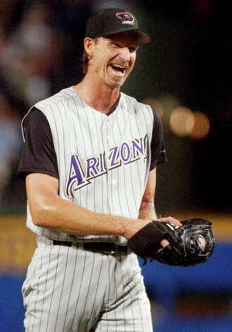 FILE - In this May 18, 2004, file photo, Arizona Diamondbacks starter Randy Johnson reacts after pitching a perfect game against the Atlanta Braves in Atlanta. Johnson was elected to the National Baseball Hall of Fame Tuesday, Jan. 6, 2015. (AP Photo/John Bazemore, File) ORG XMIT: NY172 Photo: JOHN BAZEMORE / AP