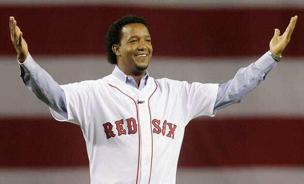FILE - In this April 4, 2010, file photo, former Boston Red Sox pitcher Pedro Martinez greets the crowd before throwing the ceremonial first pitch before the opening game of the baseball season between the Red Sox and New York Yankees, in Boston. Martinez was elected to the National Baseball Hall of Fame Tuesday, Jan. 6, 2015. (AP Photo/Elise Amendola, File) ORG XMIT: NY166 Photo: Elise Amendola / AP
