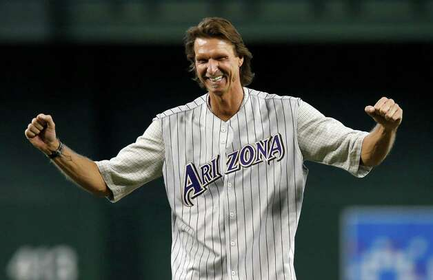 FILE - In this May 18, 2014, file photo, former Arizona Diamondbacks pitcher Randy Johnson pumps his fists after throwing out the first pitch during ceremonies commemorating the 10th anniversary of Johnson's perfect game prior to a baseball game between the Diamondbacks and the Los Angeles Dodgers in Phoenix. Johnson was elected to the National Baseball Hall of Fame on Tuesday, Jan. 6, 2015. (AP Photo/Ross D. Franklin, File) ORG XMIT: NY165 Photo: Ross D. Franklin / AP