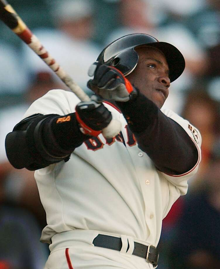 FILE - In this Aug. 18, 2004, file photo, San Francisco Giants' Barry Bonds watches a solo home run against the Montreal Expos in a baseball game in San Francisco. The chances of Rogers Clemens, Bonds, Sammy Sosa or Mark McGwire entering the Hall of Fame are dwindling. Baseball writers so far overwhelmingly have decided the outsized statistics of the Steroids Era stars are tarnished by their connection to performance-enhancing drugs use. Once again Tuesday, Jan. 6, 2015, Cooperstown's doors remained shut. (AP Photo/Marcio Jose Sanchez, File) Photo: Marcio Jose Sanchez, Associated Press