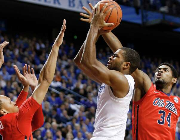 Kentucky's Andrew Harrison, center, looks for a shot between Mississippi's Terence Smith, left, and Aaron Jones (34) during the second half of an NCAA college basketball game in Lexington, Ky., Tuesday, Jan. 6, 2015. Kentucky won 89-86 in overtime. (AP Photo/James Crisp) ORG XMIT: KYJC112 Photo: James Crisp / FR6426 AP