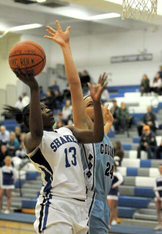 Shaker's CeCe Mayo drives to the basket defended by Columbia's Selena Lott during their girl's high school basketball game on Tuesday Jan. 6, 2015 in Latham, N.Y. (Michael P. Farrell/Times Union) Photo: Michael P. Farrell / 00030069A