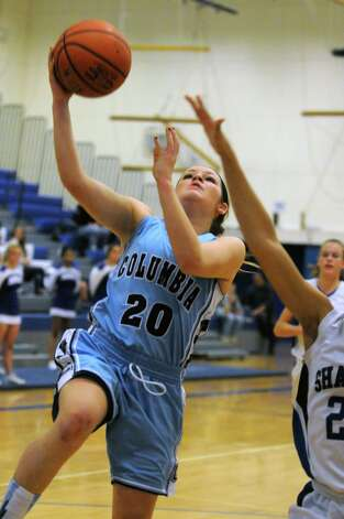 Columbia's Kaylee Arno drives to the basket during their girl's high school basketball game against Shaker on Tuesday Jan. 6, 2015 in Latham, N.Y. (Michael P. Farrell/Times Union) Photo: Michael P. Farrell / 00030069A