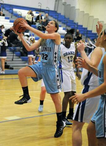 Columbia's Toni Lettrick drives to the basket during their girl's high school basketball game against Shaker on Tuesday Jan. 6, 2015 in Latham, N.Y. (Michael P. Farrell/Times Union) Photo: Michael P. Farrell / 00030069A