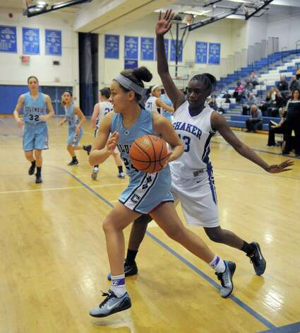 Columbia's  Selena Lott drives to the basket during their girl's high school basketball game against Shaker on Tuesday Jan. 6, 2015 in Latham, N.Y. (Michael P. Farrell/Times Union) Photo: Michael P. Farrell / 00030069A