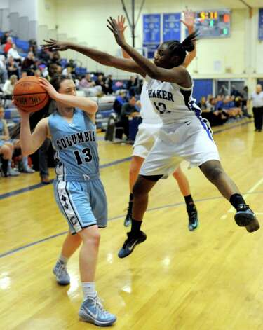 Columbia's Sarah Jaromin looks to pass defended by Shaker's CeCe Mayo during their girl's high school basketball game on Tuesday Jan. 6, 2015 in Latham, N.Y. (Michael P. Farrell/Times Union) Photo: Michael P. Farrell / 00030069A